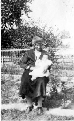 Martha Pleasant, born a slave in Virginia, holding her grandson, my father Neal Hemachandra