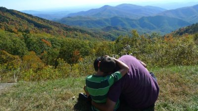Ray and Nicholas Hemachandra sitting by the Blue Ridge Parkway in North Carolina (photo by Kristi Pfeiffer)