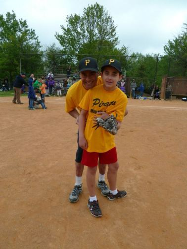 Ray and Nicholas Hemachandra at Nicholas' assisted baseball game last weekend in Asheville, North Carolina