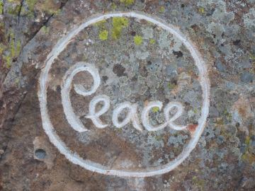 "Engraving of ""Peace"" on a rock at Magnolia Grove Monastery"