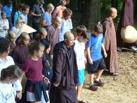 Thich Nhat Hanh leading the walking meditation at the Healing Yourself Is Healing the World Retreat at Magnolia Grove Monastery in late September 2013
