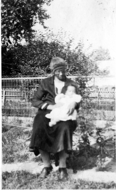 My great-grandmother, Martha Pleasant, holds my father.