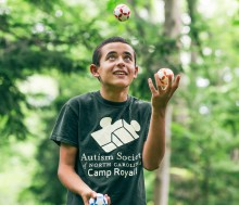 My son, Nicholas, juggles at the Asheville Botanical Gardens at University of North Carolina – Asheville. (Photo by Tim Robison for the Mountain Xpress)