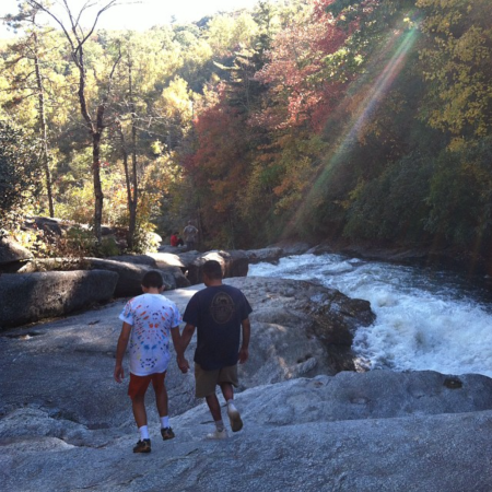 Nicholas and Ray Hemachandra at the top of Rainbow Falls (Photo by Heather Holt Hill)