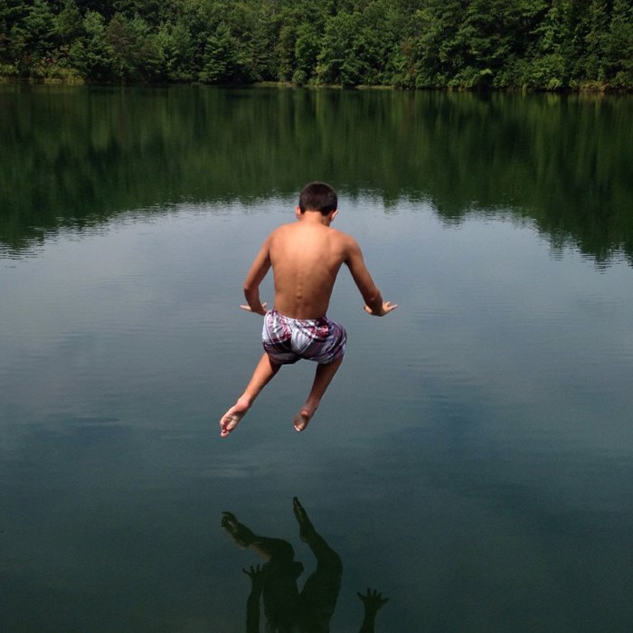 Nicholas leaps into Fawn Lake in DuPont State Forest, North Carolina.