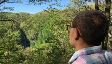 Nicholas Hemachandra looking out at Raven Cliff Falls in South Carolina, May 2020